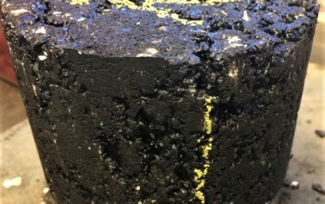 Waste-polymer enhanced asphalt